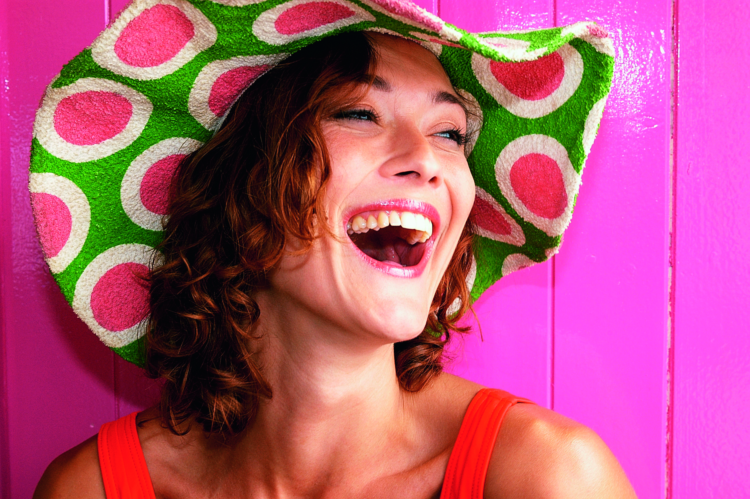 woman smiling, hat